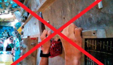 Homem fazendo treinamento físico para escalada: Tração
